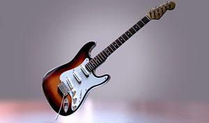 guitare électrique blanche et marron